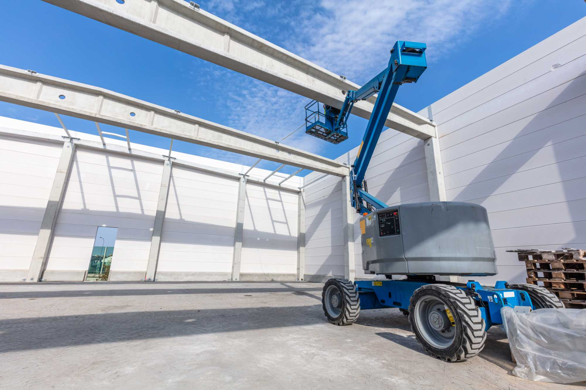 warehouse-construction-site-with-industrial-vehicl-9JMBUJE.jpg